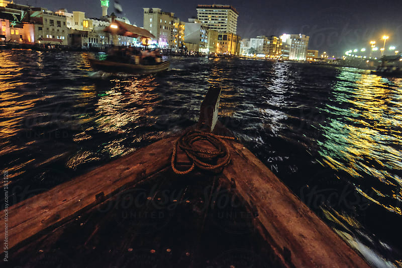 traveling with abra, traditional wooden boat by Paul Schlemmer for Stocksy United
