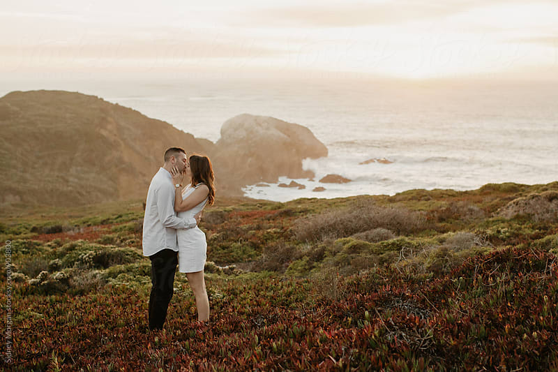 Couple on Cliff by Sidney Morgan for Stocksy United