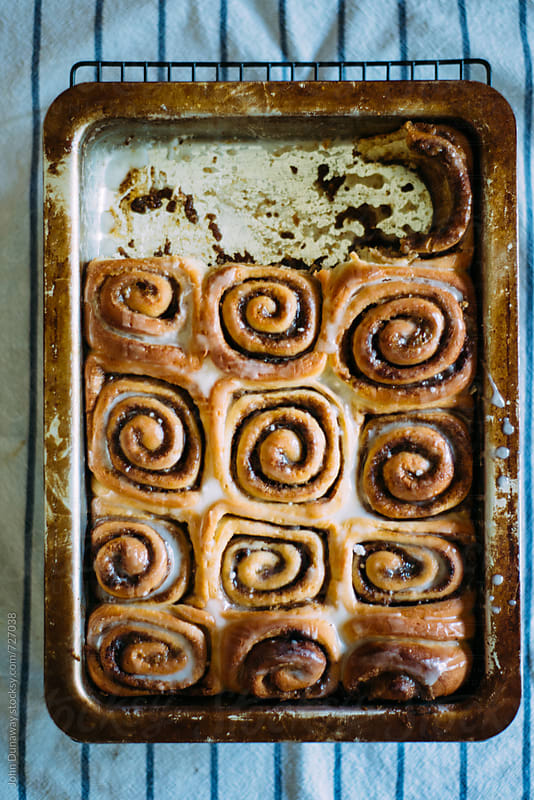 Fresh homemade cinnamon roll by John Dunaway for Stocksy United
