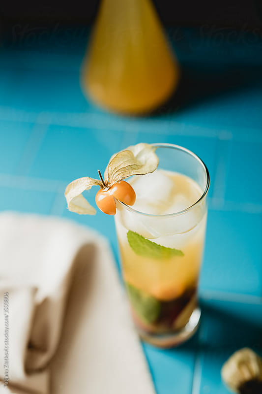 Mint iced tea with physalis by Tatjana Zlatkovic for Stocksy United
