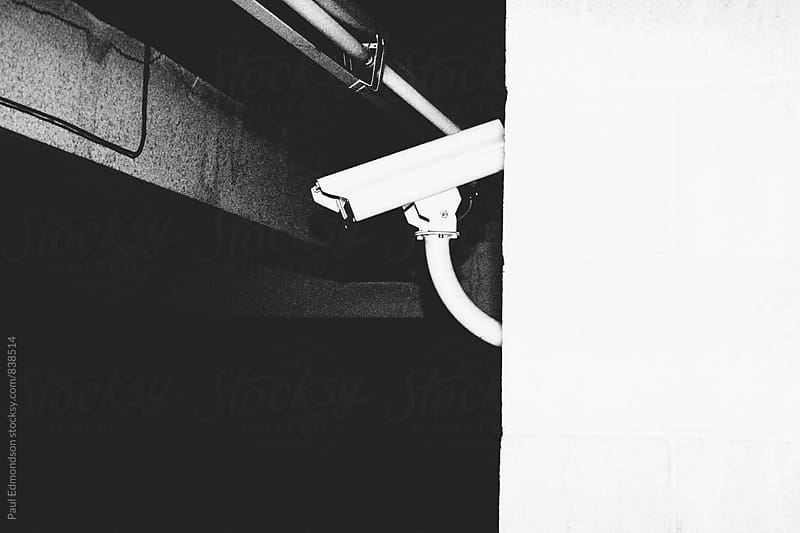 Surveillance camera in parking garage by Paul Edmondson for Stocksy United