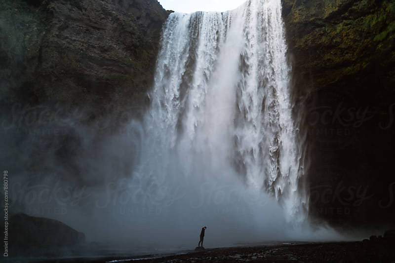 Silhouette Standing in Front of a Waterfall in Iceland by Daniel Inskeep for Stocksy United