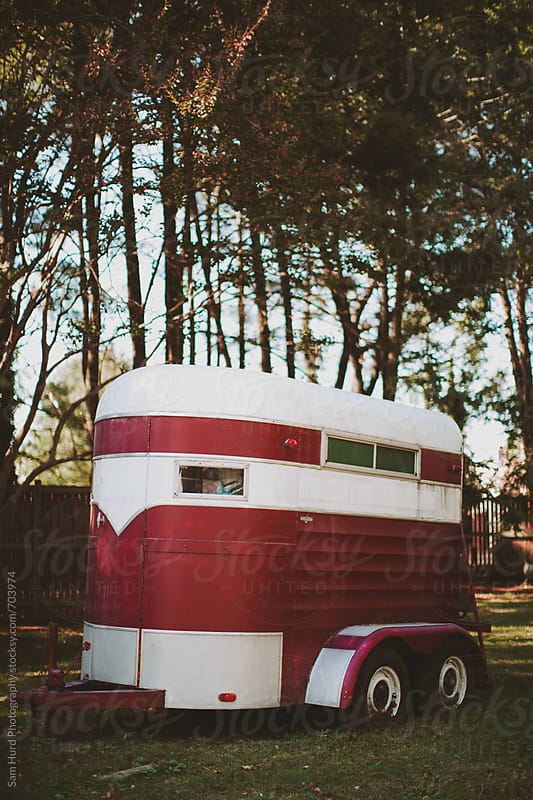 red and white trailer in the woods by Sam Hurd Photography for Stocksy United