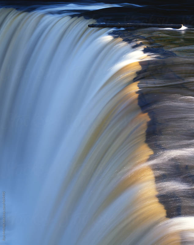 telephoto of tahquamenon falls brown tinge from tannic acid  by Ron Mellott for Stocksy United