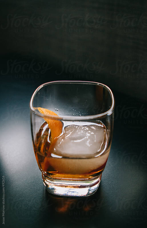 Old Fashioned Drink 2 dashes Bitters, zest of orange, whiskey, sugar cube, ice, stir by Jesse Morrow for Stocksy United