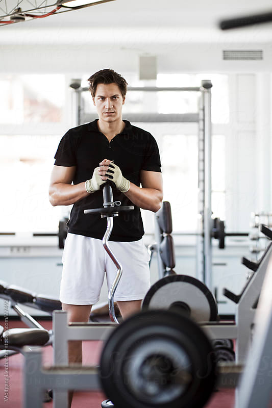 guy posing in the gym by Wolfgang Lienbacher for Stocksy United