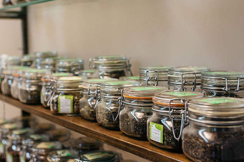 Jars on a shelf with various teas by Gabriel (Gabi) Bucataru for Stocksy United