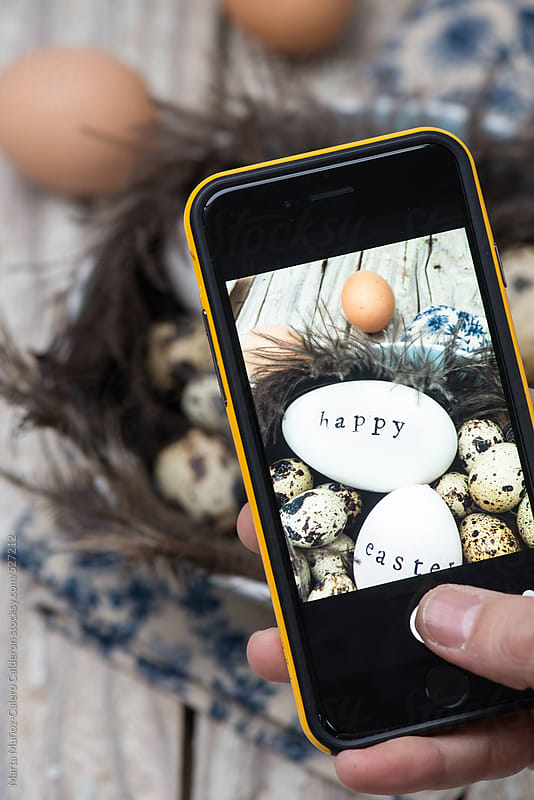 Mobile shooting easter eggs still life by Marta Muñoz-Calero Calderon for Stocksy United