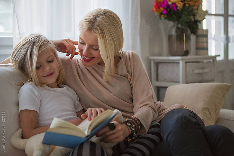 Mother and Daughter Reading a Book by Lumina for Stocksy United