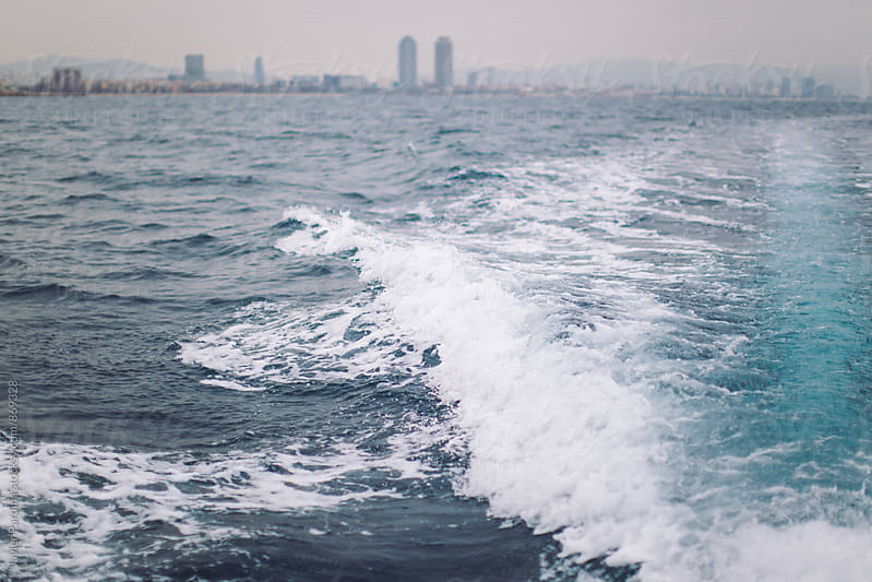 view of barcelona from the sea by Javier Pardina for Stocksy United