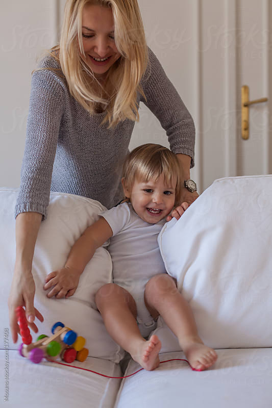 Mother Playing With Her Son by Mosuno for Stocksy United