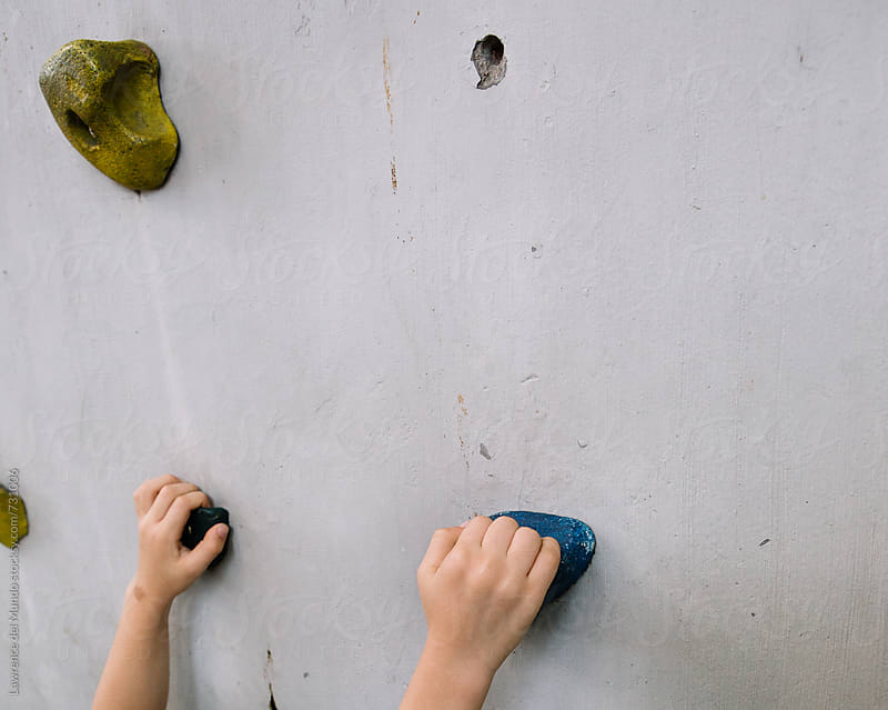 Hands of a very young kid practicing to be a rock climber by Lawrence del Mundo for Stocksy United