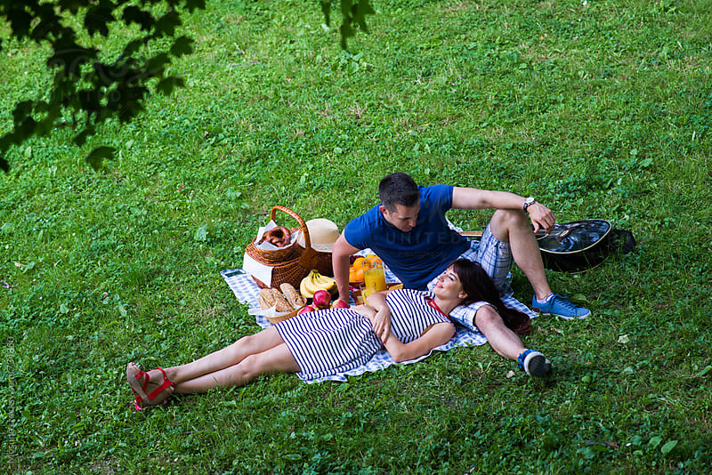 Couple Having Picnic in Nature by Mosuno for Stocksy United