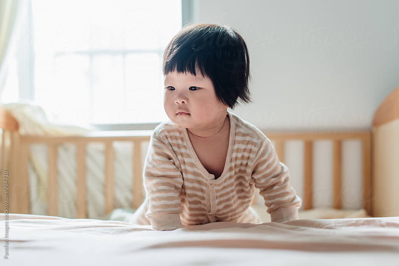 Cute Chinese baby girl by Xunbin Pan for Stocksy United