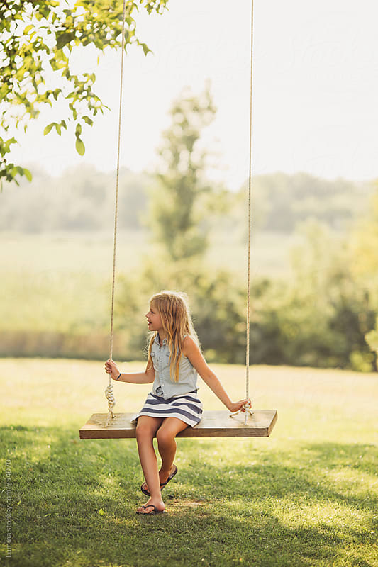 Blonde Girl Sitting on a Swing by Lumina for Stocksy United