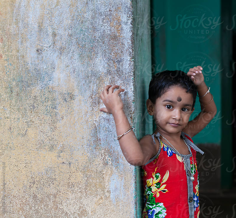 A little girl looking at camera by PARTHA PAL for Stocksy United