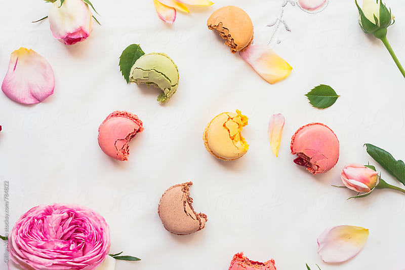 colourful macarons with bites taken out by Gillian Vann for Stocksy United