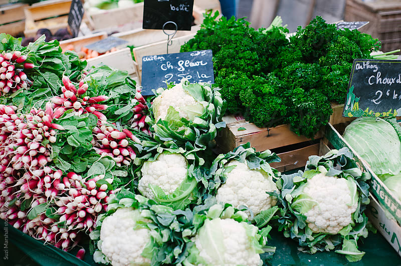 Fresh vegetables for sale at a street market in France by Suzi Marshall for Stocksy United