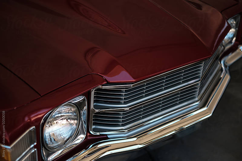 Detail of a vintage American muscle car's front grill by Riley Joseph for Stocksy United