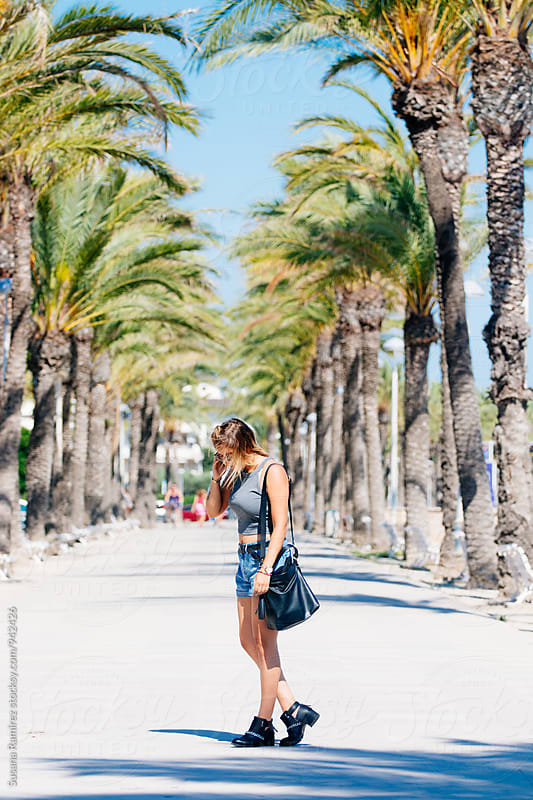Woman walking in summer by Susana Ramírez for Stocksy United