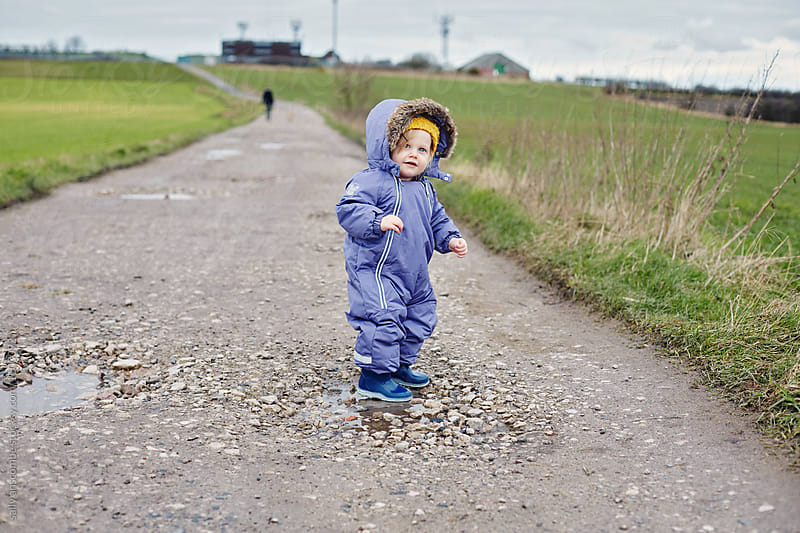 Child out for a walk in the countryside by sally anscombe for Stocksy United