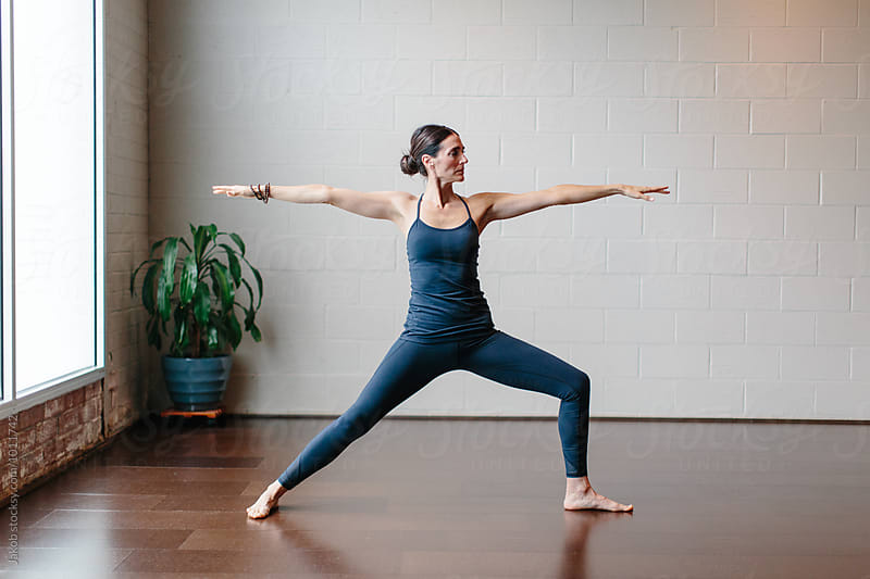Beautiful woman practicing yoga in a studio  by Jakob for Stocksy United