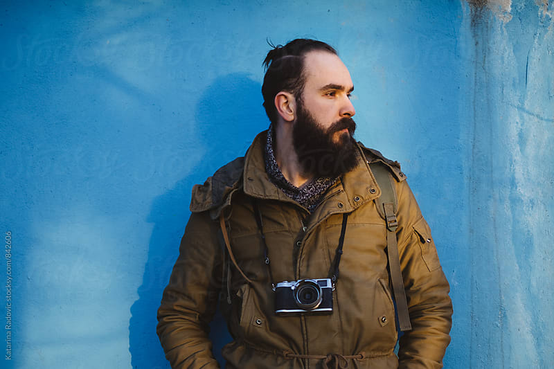 Bearded Man Posing in Front of the Blue Wall by Katarina Radovic for Stocksy United