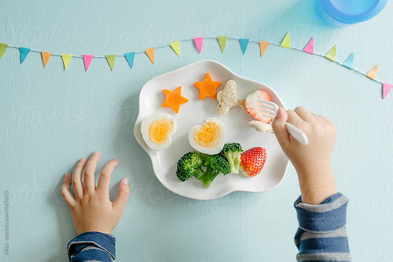 Fussy eater by Alita Ong for Stocksy United