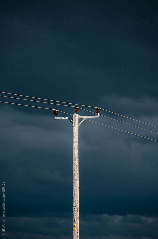 Storm Clouds and Powerlines by Neil Warburton for Stocksy United