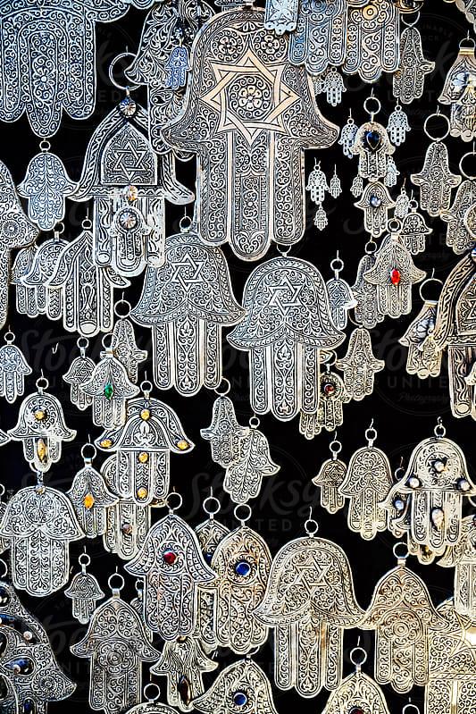 Assortment of hamsa amulets in a souk market by Alejandro Moreno de Carlos for Stocksy United