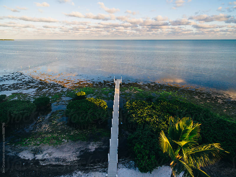 Drone aerial of a long pier in the Atlantic Ocean by Jen Grantham for Stocksy United