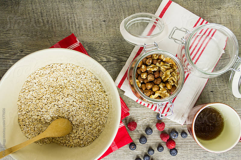 Mixing up granola by Kirsty Begg for Stocksy United