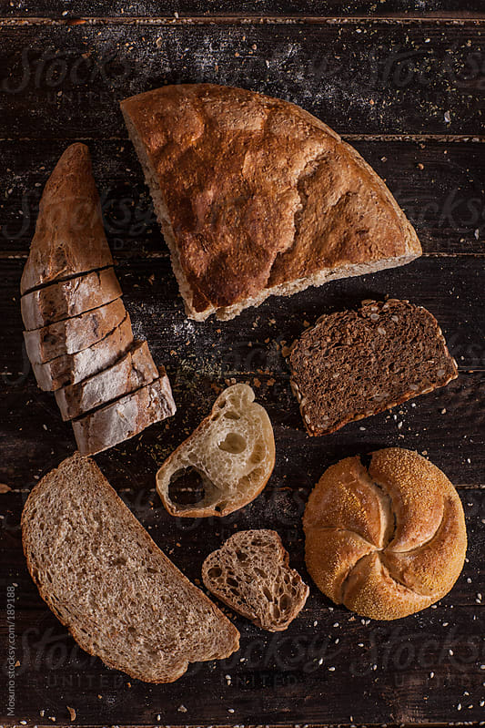 Different Types of Bread on a Wooden Table by Mosuno for Stocksy United