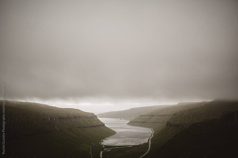 Overcast Natural Harbor in between the Cliffs of the Faroe Islands by Rachel Gulotta Photography for Stocksy United