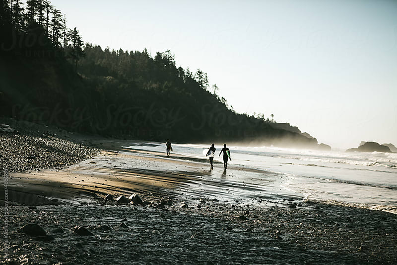 Surfers Walking the Oregon Coast by Kristine Weilert for Stocksy United