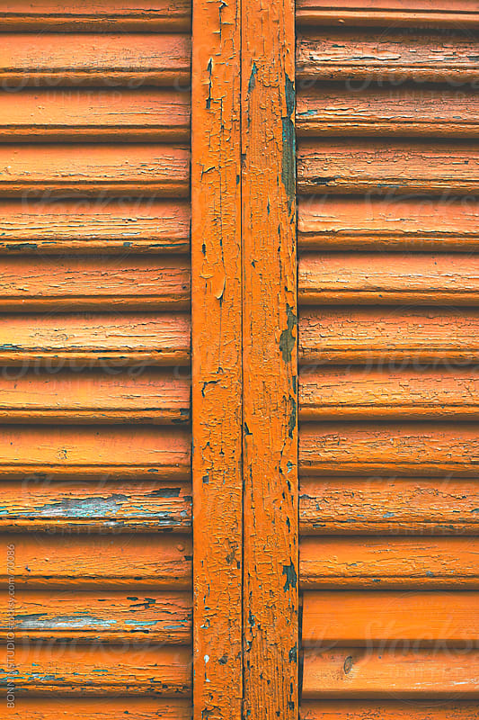 Orange old wood painted blind. by BONNINSTUDIO for Stocksy United