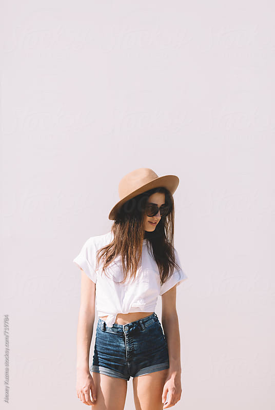 young woman with hat by Alexey Kuzma for Stocksy United