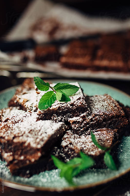 Homade brownies on a plate by Gabriel (Gabi) Bucataru for Stocksy United