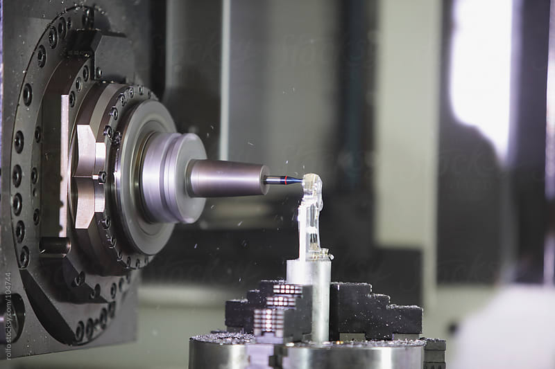 CNC machine drilling by rolfo for Stocksy United