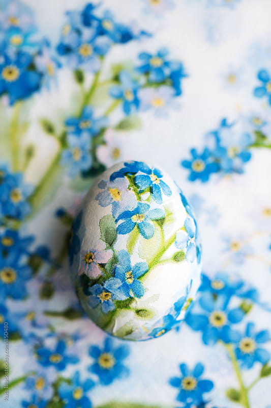 Decoupage Easter egg decorated with paper napkins by Ruth Black for Stocksy United