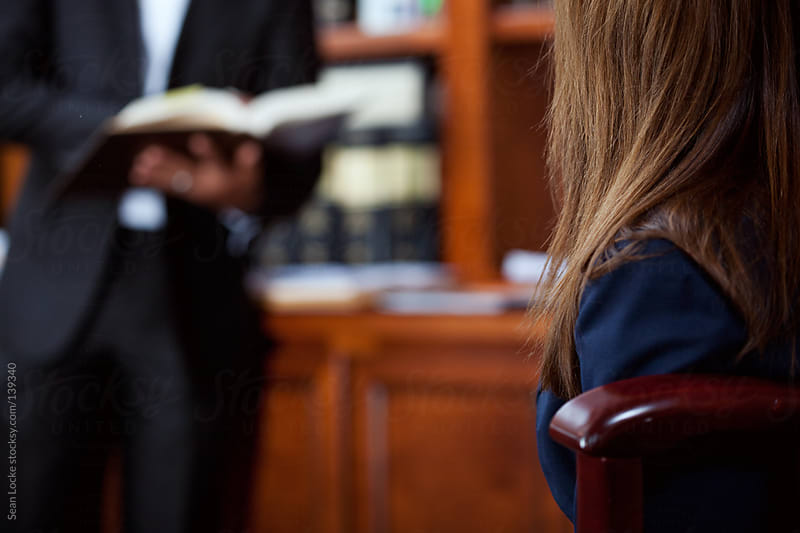 Lawyer: Woman Waits For Lawyer To Find Information by Sean Locke for Stocksy United