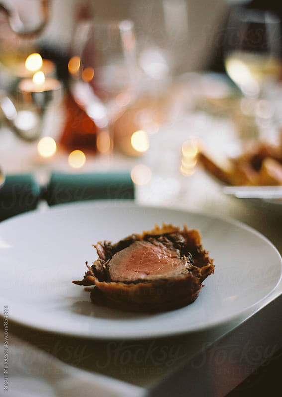Slice of beef on a plate at Christmas by Kirstin Mckee for Stocksy United