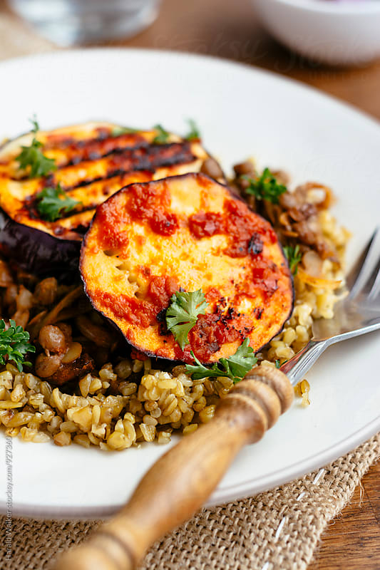 Middle-eastern freekeh lentil and harrisa eggplant by Harald Walker for Stocksy United