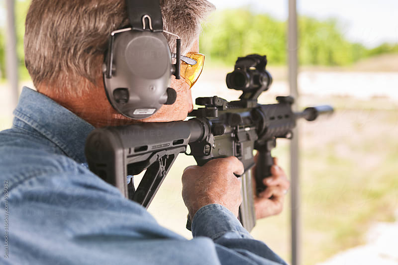Shooting: Man Taking Target Practice With An AR-15 Rifle