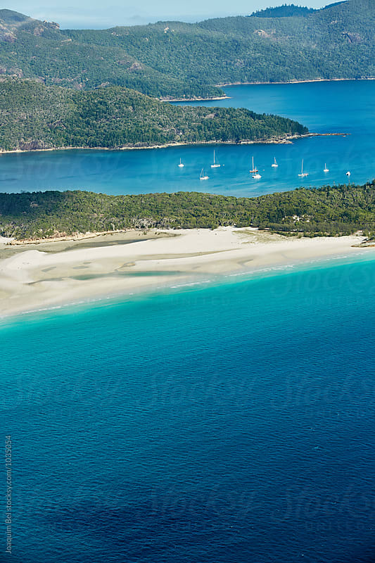 Boats mooring in the Whitsunday Islands by Joaquim Bel for Stocksy United