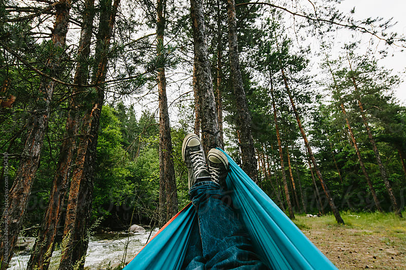 Lying in hammock in nature by Aleksandar Novoselski for Stocksy United