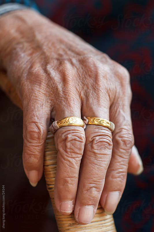 old lady hand by zheng long for Stocksy United