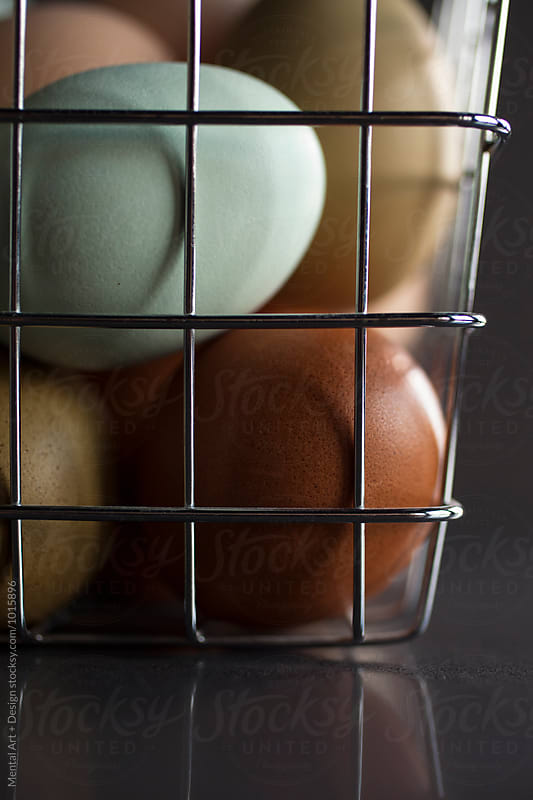 Eggs in a basket by Mental Art + Design for Stocksy United