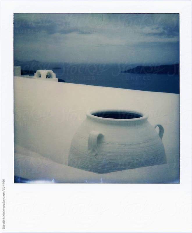 Polaroid of urn in Santorini by Kirstin Mckee for Stocksy United
