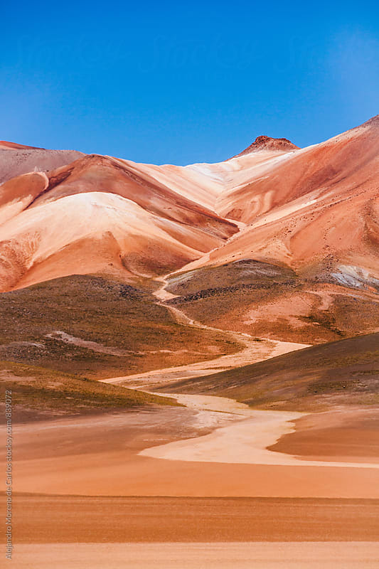 Red sand mountain in desert landscape, Bolivia by Alejandro Moreno de Carlos for Stocksy United
